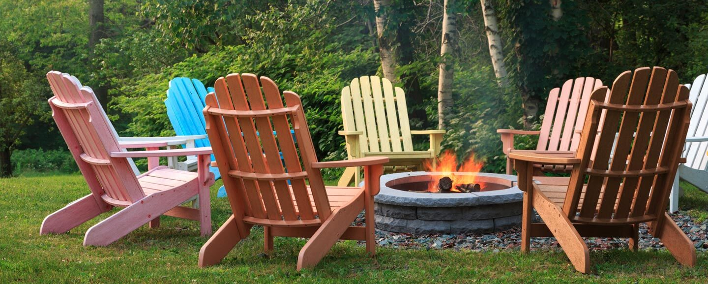 Empty chairs surround a fire pit