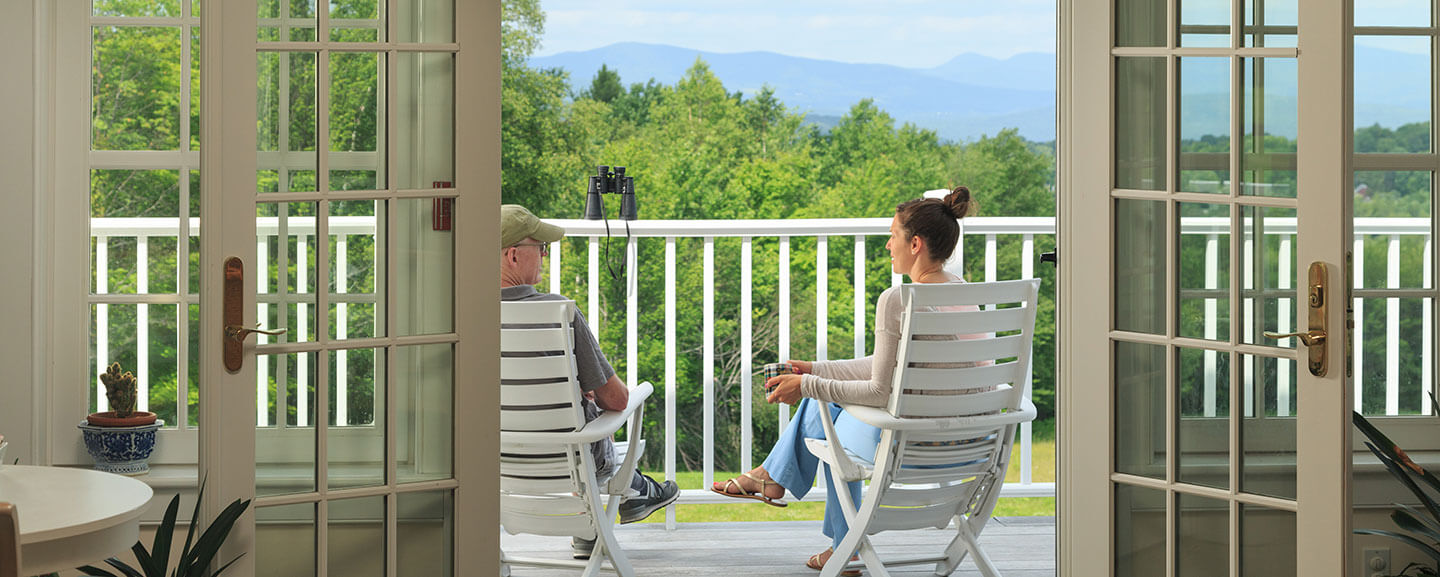 A couple enjoy the view from the back porch